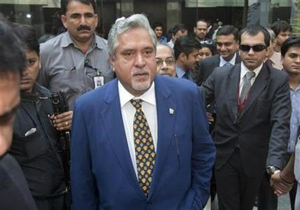 Vijay Mallya (C) arrives for a news conference in Mumbai November 15, 2011. REUTERS/Vivek Prakash/Files