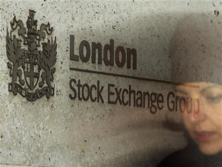 A City worker passes the Stock Exchange in London February 9, 2011. REUTERS/Luke MacGregor