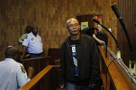 Thai national Chumlong Lemtongthai enters the dock during a hearing at Kempton Park Magistrate's Court November 7, 2012. REUTERS/Siphiwe Sibeko