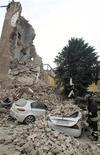 Gli effetti del crollo della torre del Castello Delle Rocche a Finale Emilia, 20 maggio 2012. REUTERS/Giorgio Benvenuti