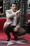 El oscarizado actor española Javier Bardem estrenó el viernes su estrella en el Paseo de la Fama de Hollywood, colocada justo a lado de su esposa, la también oscarizada Penélope Cruz. En la imagen, Javier Bardem en la ceremonia de homenaje en el Paseo de la Fama de Hollywood, California, el 8 de noviembre de 2012. REUTERS/Jonathan Alcorn