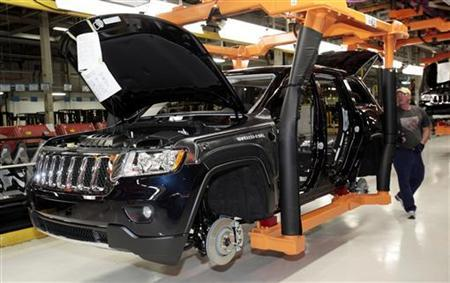 The all-new 2011 Jeep Grand Cherokee moves along the assembly line at the Jefferson North Assembly Plant in Detroit, Michigan May 21, 2010. REUTERS/Rebecca Cook