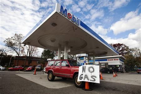 A ''no gas'' sign is seen in front of a vehicle that ran out of fuel in front of a gas station in Staten Island due to shortages following Hurricane Sandy, in New York in this November 2, 2012, file photo. REUTERS/Lucas Jackson/Files