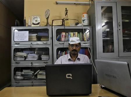 Arvind Kejriwal works on his laptop after his interview with Reuters in Ghaziabad on the outskirts of New Delhi October 22, 2012. REUTERS/Mansi Thapliyal