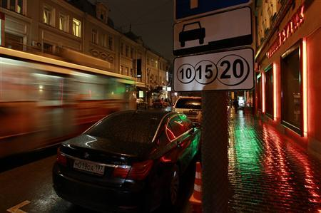 A tram passes a car parked in a paid street parking space in Moscow November 9, 2012. REUTERS/Sergei Karpukhin