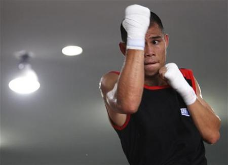Chris ''The Dragon'' John of Indonesia shadow boxes during an open training session ahead of his fight at a gym in Singapore November 6, 2012. REUTERS/Edgar Su