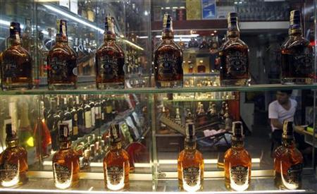 Whisky bottles are displayed for sale at a shop in Hanoi June 6, 2012. REUTERS/Kham
