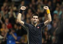 Serbia's Novak Djokovic celebrates his win over Czech Republic's Tomas Berdych following their men's singles tennis match at the ATP World Tour Finals at the O2 Arena in London November 9, 2012. REUTERS/Suzanne Plunkett