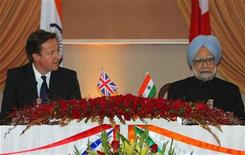 British Prime Minister David Cameron (L) and his Indian counterpart Manmohan Singh attend a joint news conference in New Delhi in this file photo taken July 29, 2010. REUTERS/B Mathur