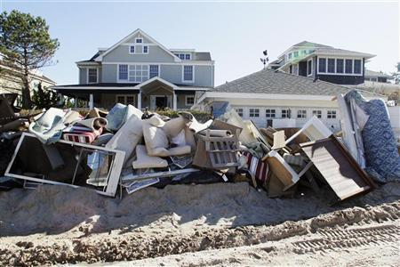 Water-damaged furniture and belongings are piled high on sand along East Avenue in the aftermath of Hurricane Sandy, at Bay Head, New Jersey November 4, 2012. REUTERS/Tom Mihalek