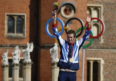Gold medallist Britain's Bradley Wiggins celebrates on the podium during the victory ceremony for the men's cycling individual time trial at the London 2012 Olympic Games at Hampton Court Palace August 1, 2012. REUTERS/Paul Hanna