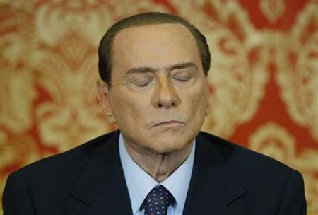 Italy's former Prime Minister Silvio Berlusconi listens during a news conference at Villa Gernetto in Gerno near Milan October 27, 2012. REUTERS/Alessandro Garofalo/Files