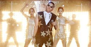 """South Korean singer Psy performs his hit """"Gangnam Style"""" during a morning television appearance in central Sydney October 17, 2012. REUTERS/Tim Wimborne"""