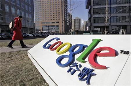A woman walks past the logo of Google in front of its headquarters in Beijing January 12, 2011. REUTERS/Christina Hu/Files