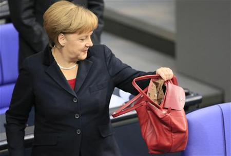 German Chancellor Angela Merkel arrives for a session of the lower house of parliament Bundestag in Berlin November 9, 2012. REUTERS/Tobias Schwarz