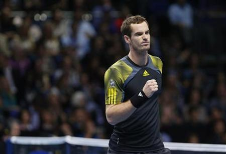 Britain's Andy Murray celebrates winning a game against France's Jo-Wilfried Tsonga during their men's singles tennis match at the ATP World Tour Finals at the O2 Arena in London November 9, 2012. REUTERS/Suzanne Plunkett
