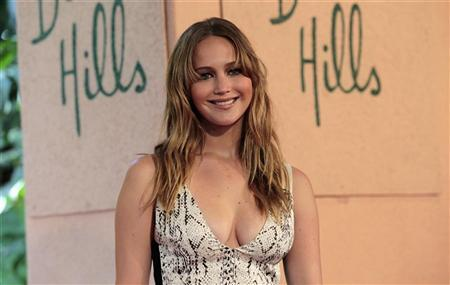 Actress Jennifer Lawrence poses at The Hollywood Foreign Press Association's (HFPA) annual luncheon to announce financial grants to film schools and non-profit organizations at the Beverly Hills hotel in Beverly Hills, California August 9, 2012. REUTERS/Mario Anzuoni
