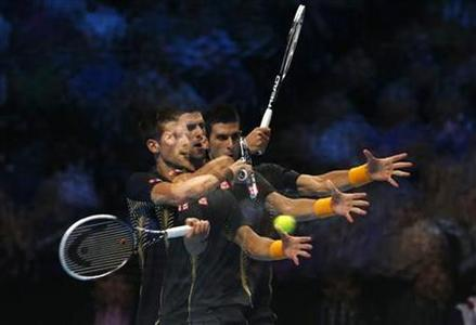 A multiple exposure photograph shows Serbia's Novak Djokovic as he hits a return to Czech Republic's Tomas Berdych during their men's singles tennis match at the World Tour Finals at the O2 Arena in London November 9, 2012. REUTERS/Suzanne Plunkett