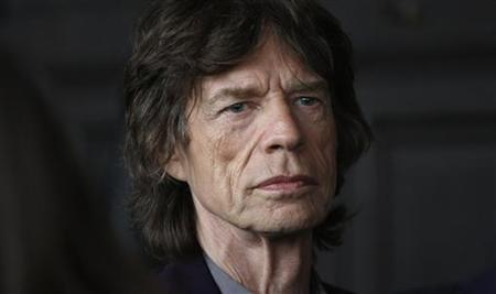 Musician Mick Jagger is seen before the L'Wren Scott Fall/Winter 2012 collection during New York Fashion Week February 16, 2012. REUTERS/Carlo Allegri
