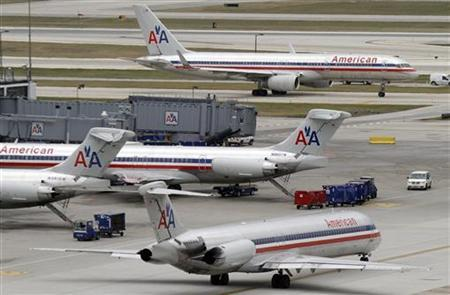 American Airlines planes sit at their gates while others taxi for arrival and departure at O'Hare International airport in Chicago November 29, 2011. REUTERS/Frank Polich