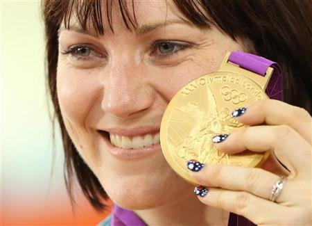 Australia's Anna Meares holds up her gold medal after the track cycling women's sprint finals at the Velodrome during the London 2012 Olympic Games August 7, 2012. REUTERS/Stefano Rellandini