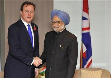 Britain's Prime Minister David Cameron (L) shakes hands with India's Prime Minister Manmohan Singh ahead of a bilateral meeting before the start of the G20 Summit of major world economies in Cannes November 3, 2011. REUTERS/Toby Melville