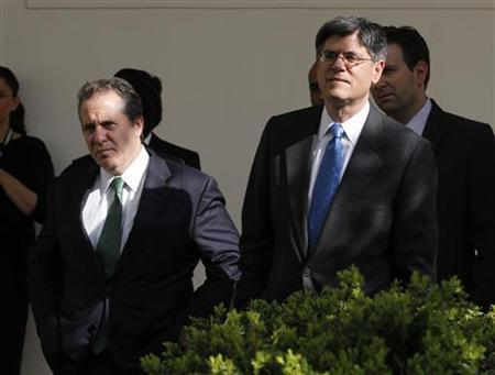 White House Chief of Staff Jack Lew and Director of the National Economic Council, Gene Sperling (L) in the Rose Garden of the White House in Washington, March 23, 2012. REUTERS/Jason Reed/Files