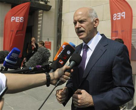 Former Greek Prime Minister George Papandreou talks to the media as he arrives at a meeting of the Party of European Socialists (PES) ahead of an informal EU leaders summit in Brussels May 23, 2012. REUTERS/Ezequiel Scagnetti