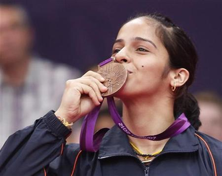 Saina Nehwal kisses her bronze medal at the women's singles badminton victory ceremony at the London 2012 Olympic Games at the Wembley Arena August 4, 2012. REUTERS/Bazuki Muhammad/Files