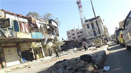 Residents walk near damaged buildings in Al Mahata, near Deraa, November 9, 2012. REUTERS/Al-Mutsem Be-Allah/Shaam News Network/Handout
