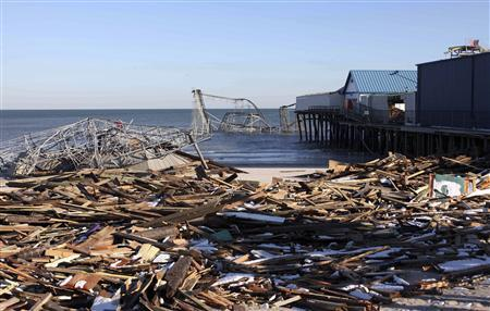 The boardwalk and Casino Pier lie in ruins caused by Hurricane Sandy in Seaside Park, New Jersey November 9, 2012, in this handout photo courtesy of the governor's office. REUTERS/New Jersey Governor's Office/Tim Larsen/Handout