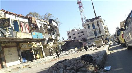 Residents walk near damaged buildings in Al Mahata, near Deraa, November 9, 2012. REUTERS/Al-Mutsem Be-Allah/Shaam News Network/Handout