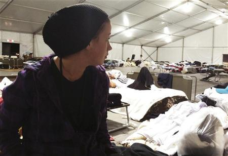 Ashley Sabol, 21, of Seaside Heights, New Jersey looks over her accommodations at Tent City in Monmouth Park in Oceanport, New Jersey November 9. 2012. REUTERS/Michelle Conlin