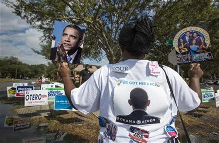Tonya Lewis, a supporter of President Barack Obama, rallies outside a polling station during the U.S. presidential election in Tampa, Florida November 6, 2012. REUTERS/Scott Audette