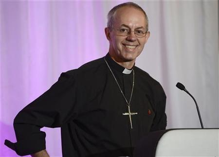 The Bishop of Durham, and the newly appointed Archbishop of Canterbury, Justin Welby, smiles during a news conference at Lambeth Palace in London November 9, 2012. REUTERS/Dylan Martinez