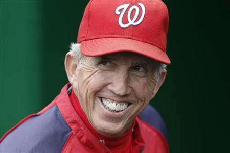 Washington Nationals manager Davey Johnson smiles on the field before his team's MLB National League baseball game against the Philadelphia Phillies in Washington, October 1, 2012. REUTERS/Jonathan Ernst