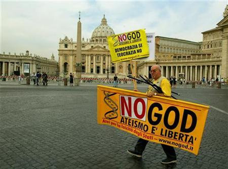 A demonstrator walks with a banner during a pro-gay protest outside Saint Peter's Square in Rome. REUTERS/Dylan Martinez