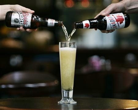 Coors Light and Molson Candian beer are poured into a glass in Toronto in this July 22, 2004 file photograph. One result of the 2008-2009 recession that reduced manufacturing jobs in places such as Milwaukee has been slower traffic at some bars, and sluggish beer sales nationwide over the past four years, according to industry analysts.  REUTERS/Andy Clark/Files