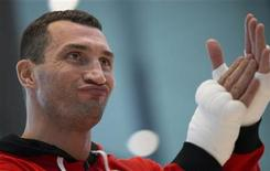 Ukrainian WBO, IBO and IBF heavy weight boxing world champion Vladimir Klitschko reacts during a public training session in Hamburg November 7, 2012. REUTERS/Morris Mac Matzen
