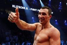 Ukrainian WBO, IBO, IBF and WBA heavyweight boxing world champion Vladimir Klitschko gestures as he celebrates his victory over Polish challenger Mariusz Wach after their title bout in Hamburg November 10, 2012. World heavyweight champion Klitschko was made to go the distance against Wach but earned a unanimous points decision on Saturday to retain his four title belts. REUTERS/Morris Mac Matzen