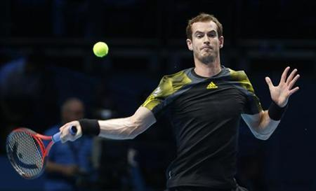 Britain's Andy Murray hits a return to France's Jo-Wilfried Tsonga during their men's singles tennis match at the ATP World Tour Finals at the O2 Arena in London November 9, 2012. REUTERS/Suzanne Plunkett