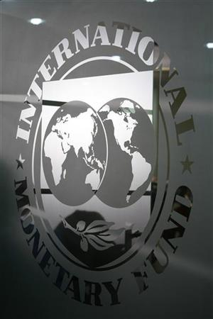 The International Monetary Fund (IMF) logo is seen during a news conference in Bucharest March 25, 2009. REUTERS/Bogdan Cristel