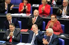 Peer Steinbrueck (front C) of the opposition Social Democratic Party (SPD) receives applause from his party fellows after his speech at a session of the German lower house of parliament Bundestag, in Berlin October 18, 2012. REUTERS/Tobias Schwarz (GERMANY - Tags: POLITICS)