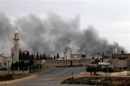 Smoke rises from burnt factories after being shelled at Khan al-Assal November 10, 2012. REUTERS/Zain Karam