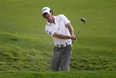 Rory McIlroy of Northern Ireland hits out of bunker on the first hole during the third round of the Barclays Singapore Open golf tournament in Sentosa November 10, 2012. REUTERS/Edgar Su