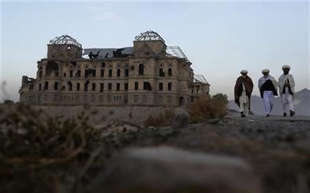 Afghan men walk past the ruins of Darulaman Palace in Kabul November 9, 2012. REUTERS/Adnan Abidi