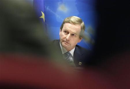 Ireland's Prime Minister Enda Kenny holds a news conference at the end of a European Union leaders summit in Brussels October 19, 2012. REUTERS/Sebastien Pirlet/Files