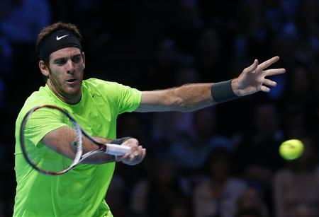 Argentina's Juan Martin Del Potro hits a return to Serbia's Novak Djokovic during their men's singles semifinal tennis match at the World Tour Finals at the O2 Arena in London November 11, 2012. REUTERS/Suzanne Plunkett