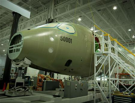 The Bombardier C-Series jet is seen under construction at its Mirabel, Quebec plant in this handout photograph released to Reuters on October 15, 2012. REUTERS/Bombardier Inc/Handout (CANADA - Tags: TRANSPORT BUSINESS) NO SALES. NO ARCHIVES. FOR EDITORIAL USE ONLY. NOT FOR SALE FOR MARKETING OR ADVERTISING CAMPAIGNS. THIS IMAGE HAS BEEN SUPPLIED BY A THIRD PARTY. IT IS DISTRIBUTED, EXACTLY AS RECEIVED BY REUTERS, AS A SERVICE TO CLIENTS