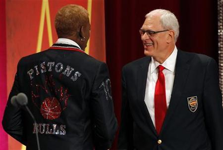 Inductee Dennis Rodman (L) and his presenter Hall of Fame Coach Phil Jackson take the stage during the Naismith Memorial Basketball Hall of Fame Class of 2011 Enshrinement Ceremony in Springfield, Massachusetts August 12, 2011. REUTERS/Brian Snyder